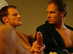Cute gay plays with heavy snake on sofa