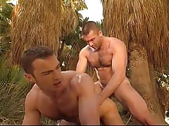 Hairy gay gentleman humps stud in doggy style in jungle