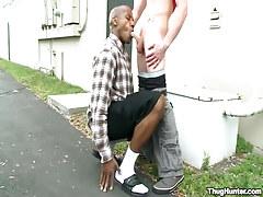 Dark guy greedily mouths stick outdoor