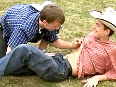 Adorable lil cowboys participate cock swallowing caresses on grass